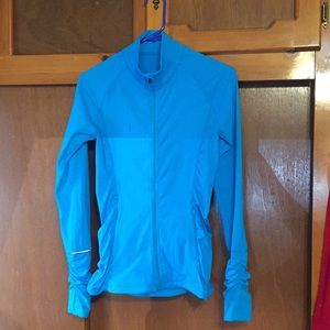 VSX Sport teal/turquoise knockout workout jacket.